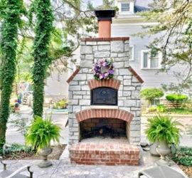 Custom built brick oven with fireplace from Round Grove Products